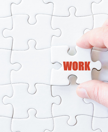 missing link: Missing jigsaw puzzle piece with word  WORK. Business concept image for completing the puzzle.