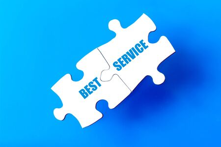 available: Connected puzzle pieces with text BEST SERVICE  isolated over blue background, with copy space available