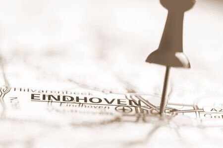Pushpin showing Eindhoven City On Map, Netherlands  with vintage sepia filter effect photo