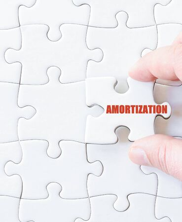 amortization: Last puzzle piece with word  AMORTIZATION. Concept image Stock Photo