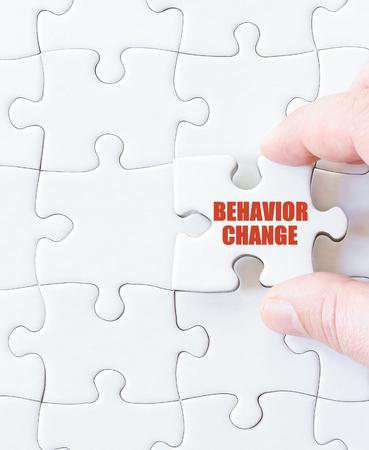 behavior: Last puzzle piece with words  BEHAVIOR CHANGE. Concept image Stock Photo