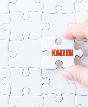 Last puzzle piece with word KAIZEN. concept image Stock Photo