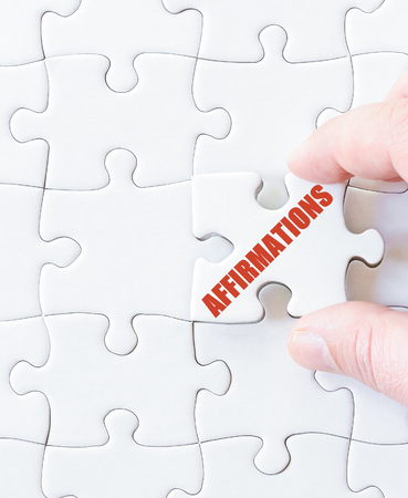 affirmations: Last puzzle piece with word  AFFIRMATIONS. Concept image