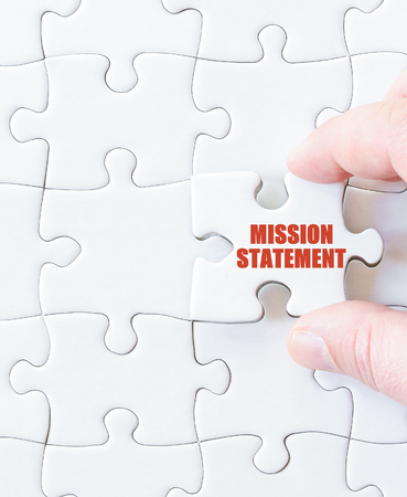 Last puzzle piece with words MISSION STATEMENT. Concept image 스톡 콘텐츠