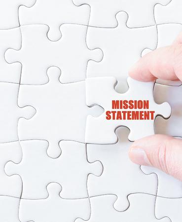 Last puzzle piece with words MISSION STATEMENT. Concept image Standard-Bild