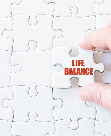 life balance: Last puzzle piece with words  LIFE BALANCE. Concept image