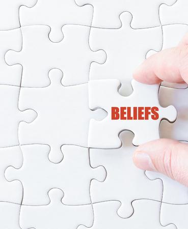 beliefs: Last puzzle piece with word  BELIEFS. Concept image