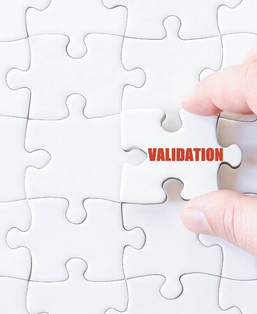 validation: Last puzzle piece with word  VALIDATION. Concept image