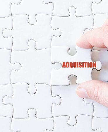 acquisition: Last puzzle piece with word  ACQUISITION. Concept image