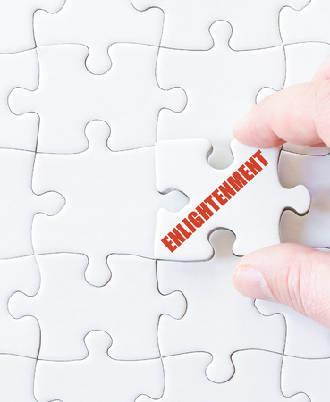 enlightenment: Last puzzle piece with word  ENLIGHTENMENT. Concept image Stock Photo