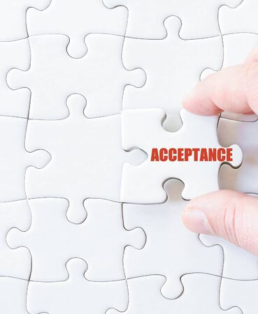 Last puzzle piece with word  ACCEPTANCE. Concept image Stock Photo