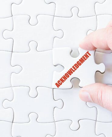 acknowledgment: Last puzzle piece with word  Acknowledgment. Concept image
