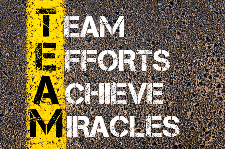 efforts: Concept image of Business Acronym TEAM as TEAM EFFORTS ACHIEVE MIRACLES written over road marking yellow paint line.