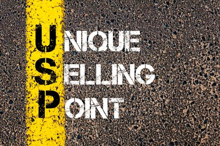 usp: Concept image of Business Acronym USP as UNIQUE SELLING POINT written over road marking yellow paint line. Stock Photo