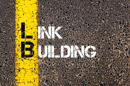 link building: Concept image of Business Acronym LB as LINK BUILDING  written over road marking yellow paint line.