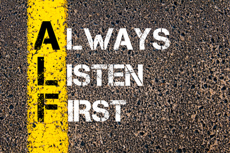 Concept image of Business Acronym ALF as ALWAYS LISTEN FIRST written over road marking yellow paint line.