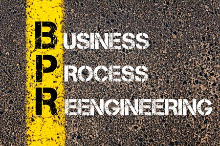 reengineering: Concept image of Business Acronym BPR as BUSINESS PROCESS REENGINEERING written over road marking yellow paint line. Stock Photo