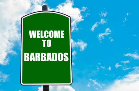 Green road sign with greeting message WELCOME TO BARBADOS isolated over clear blue sky background with available copy space. Travel destination concept  image photo