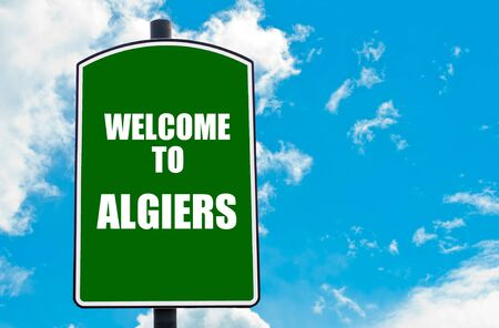 algiers: Green road sign with greeting message WELCOME TO ALGIERS isolated over clear blue sky background with available copy space. Travel destination concept  image