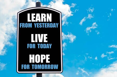 yesterday: LEARN FROM YESTERDAY, LIVE FOR TODAY, HOPE FOR TOMORROW  motivational quote written on road sign isolated over clear blue sky background Stock Photo