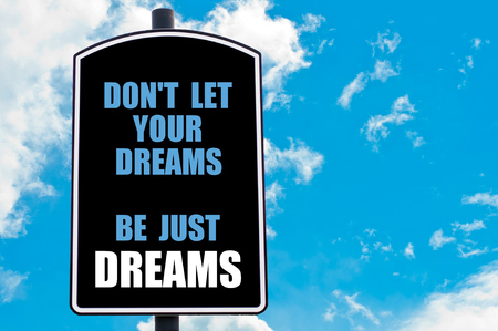 to be or not be: DO  NOT LET YOUR DREAMS BE JUST DREAMS motivational quote written on road sign isolated over clear blue sky background