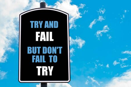 but: TRY AND FAIL BUT DO NOT FAIL TO TRY written on road sign isolated over clear blue sky background
