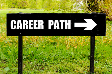 the right path: CAREER PATH written on directional black metal sign with arrow pointing to the right against natural green background