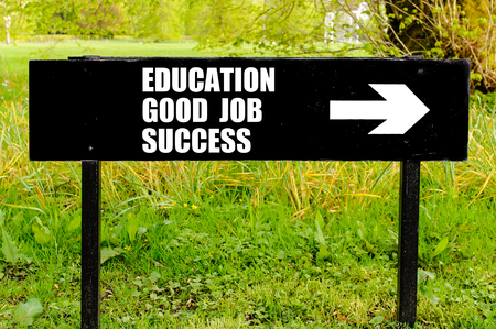 good job: Education, Good Job, Success written on directional black metal sign with arrow pointing to the right against natural green background