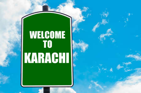 karachi: Green road sign with greeting message Welcome to KARACHI isolated over clear blue sky background with available copy space. Travel destination concept  image