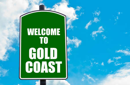 gold road: Green road sign with greeting message Welcome to  GOLD COAST isolated over clear blue sky background with available copy space. Travel destination concept  image