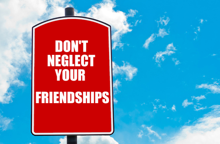 neglect: Do Not Neglect Your Friendships motivational quote written on red road sign isolated over clear blue sky background. Concept  image with available copy space