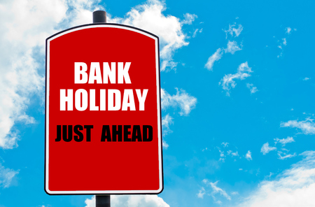 Bank Holiday Just Ahead motivational quote written on red road sign isolated over clear blue sky background. Concept  image with available copy space Stok Fotoğraf