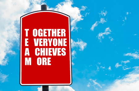achieves: Together Everyone Achieves More  motivational quote written on red road sign isolated over clear blue sky background. Concept  image with available copy space