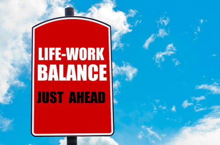 just ahead: Work Life Balance Just Ahead  motivational quote written on red road sign isolated over clear blue sky background. Concept  image with available copy space