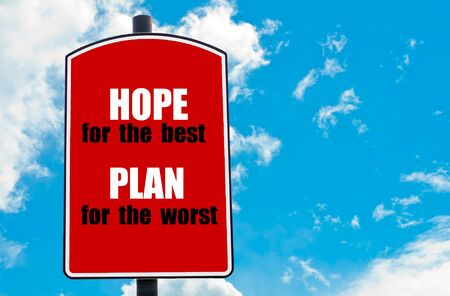the worst: Hope for the Best Plan for The Worst motivational quote written on red road sign isolated over clear blue sky background. Concept  image with available copy space Stock Photo