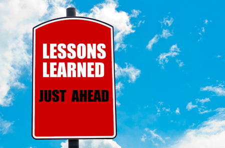 learned: Lessons Learned Just Ahead  motivational quote written on red road sign isolated over clear blue sky background. Concept  image with available copy space Stock Photo