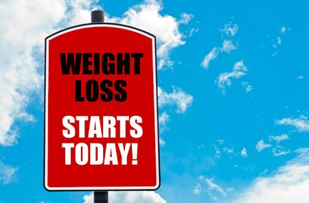 over weight: Weight Loss Starts Today  motivational quote written on red road sign isolated over clear blue sky background. Concept  image with available copy space Stock Photo