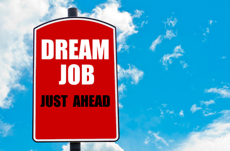 just ahead: Dream Job Just Ahead motivational quote written on red road sign isolated over clear blue sky background. Concept  image with available copy space