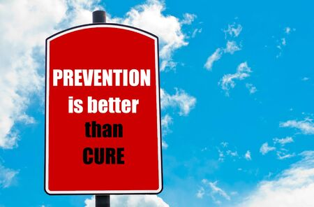 cure prevention: Prevention Is Better Than Cure motivational quote written on red road sign isolated over clear blue sky background. Concept  image with available copy space Stock Photo