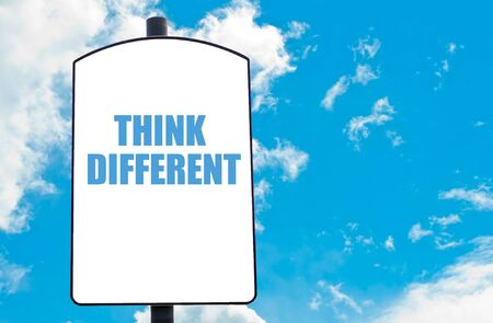 think different: Think Different motivational quote written on white road sign isolated over clear blue sky background. Concept  image with available copy space