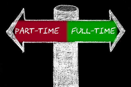Opposite arrows with Part-Time versus Full-Time. Hand drawing with chalk on blackboard. Choice conceptual image photo