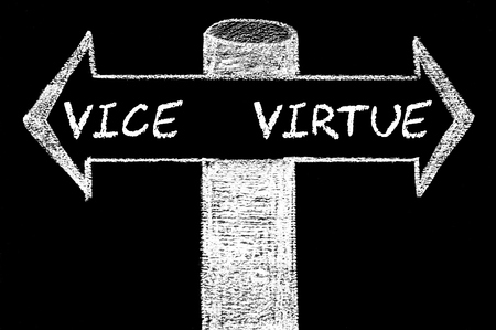 vice: Opposite arrows with Vice versus Virtue. Hand drawing with chalk on blackboard. Choice conceptual image Stock Photo