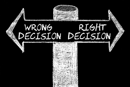 change direction: Opposite arrows with Wrong Decision versus Right Decision. Hand drawing with chalk on blackboard. Choice conceptual image