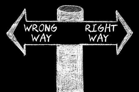 Opposite arrows with Wrong Way versus Right Way. Hand drawing with chalk on blackboard. Choice conceptual image photo