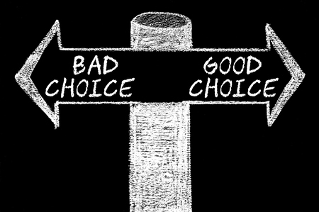 versus: Opposite arrows with Bad Choice versus Good Choice. Hand drawing with chalk on blackboard. Choice conceptual image