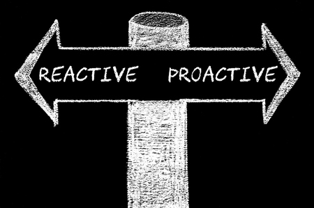 reactive: Opposite arrows with Reactive versus Proactive. Hand drawing with chalk on blackboard. Choice conceptual image