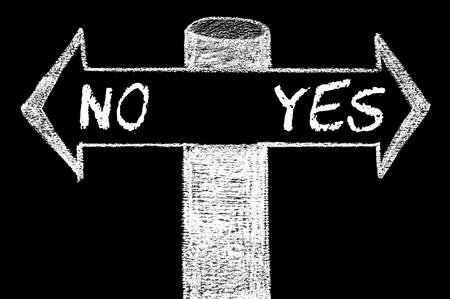 indecision: Opposite arrows with NO versus YES. Hand drawing with chalk on blackboard. Choice conceptual image Stock Photo