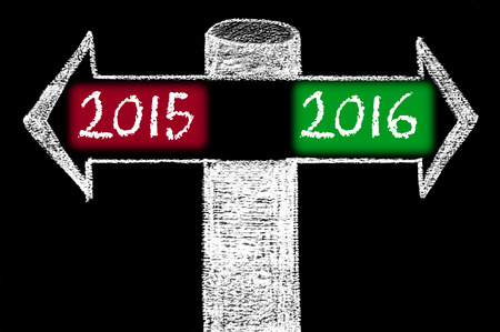 Opposite arrows with Year 2015 versus Year 2016. Hand drawing with chalk on blackboard. Choice conceptual image photo