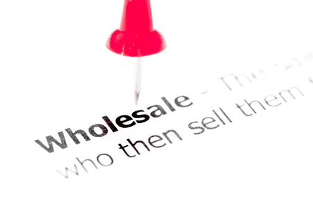 wholesale: Word WHOLESALE pinned on white paper with red pushpin, available copy space. Business Concept Stock Photo