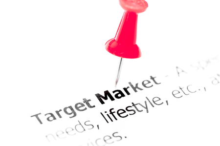 red pushpin: Words TARGET MARKET pinned on white paper with red pushpin, available copy space. Business Concept